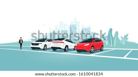 Modern car parking standing on empty or full parking lot area with man walking near vehicle. Travel park place on rest area near road highway to city. Person by car. Town skyline in the background. #1610041834