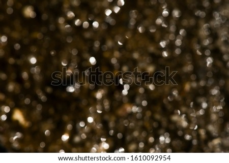 Deep brown bokeh background with light. #1610092954