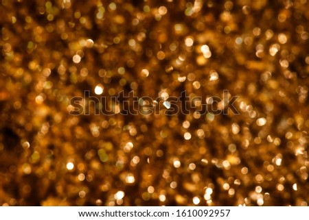 Deep brown bokeh background with light. #1610092957