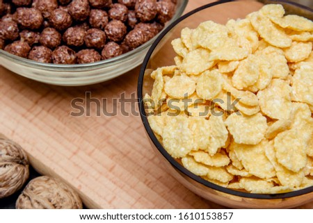 variations of cereals, raisins and walnuts on a decorative background #1610153857
