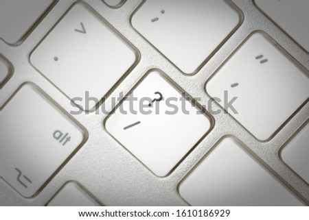 Computer keyboard - silver keyboard of a laptop with button Question Mark isolated. Home office with portable modern technology, IT and computing. #1610186929
