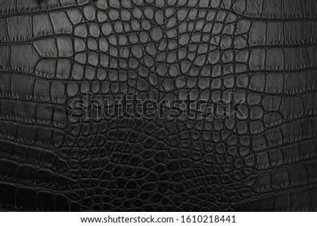 Black crocodile skin, background, texture. Royalty-Free Stock Photo #1610218441