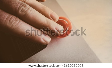 hand pushing a red button, finger on a red button. shutter button #1610232025