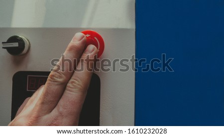 hand pushing a red button, finger on a red button. shutter button #1610232028