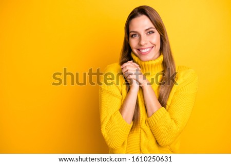 Portrait of cheerful candid girl feel grateful admire gift present she get on holidays make fists palms smiling wear bright pullover isolated over vivid color background #1610250631