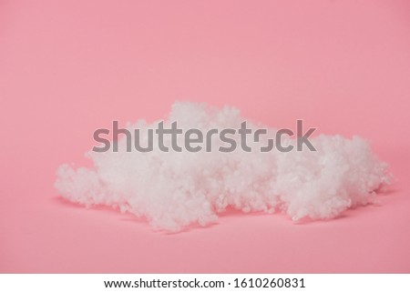 white fluffy cloud made of cotton wool on pink background #1610260831