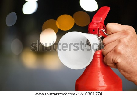 Hand presses the trigger fire extinguisher hand presses the trigger fire extinguisher #1610301274