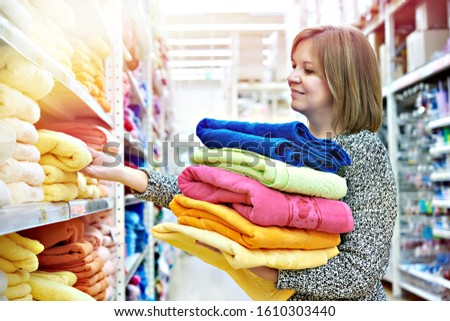 Woman buys towels in the supermarket #1610303440