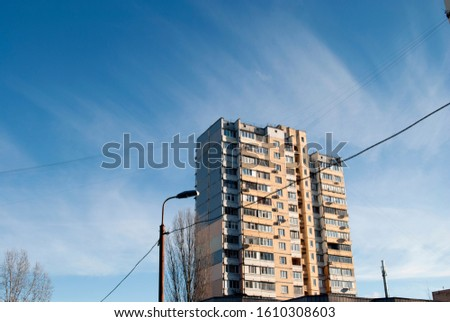Residential building in a residential area against a clear sky. Sunny weather, clear day. #1610308603