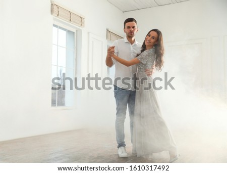 Lovely young couple dancing together in ballroom. Space for text #1610317492