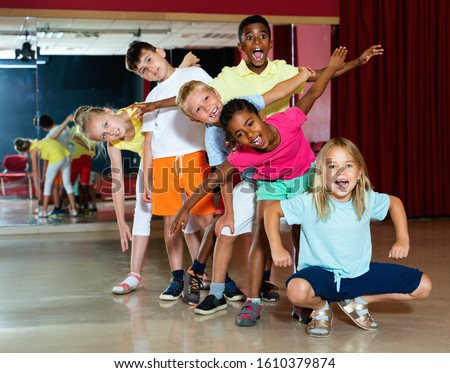 Happy emotional  smiling children posing at modern dance class  #1610379874