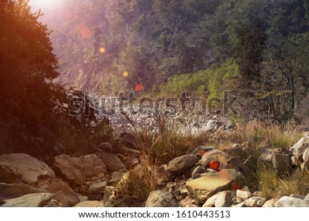 Beautiful scenic view of stone river during sunset time in Uttarakhand, India.  #1610443513