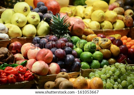 Fruit market with various colorful fresh fruits and vegetables - Market series #161053667