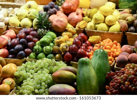 Fruit market with various colorful fresh fruits and vegetables - Market series #161053673