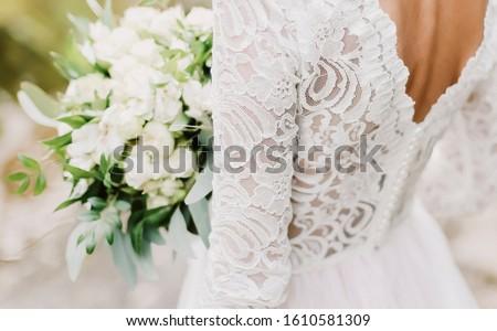 wedding dress. bride holds a wedding bouquet, wedding details #1610581309