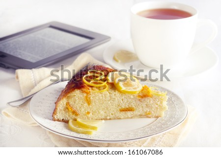 Slice of citrus cheesecake and cup of tea #161067086