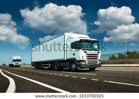 White truck is on highway - business, commercial, cargo transportation concept, clear and blank space on the side view #1610700505