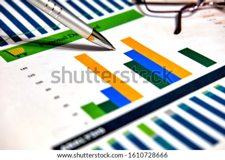 Calculation charts, business charts. Pen and glasses. #1610728666