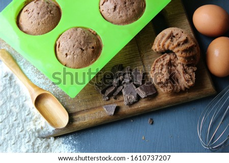 Homemade muffins with chocolate. Ingredients for baking. Copy space. Baking ingredients for chocolate brownies. #1610737207