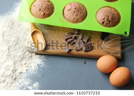 Homemade muffins with chocolate. Ingredients for baking. Copy space. Baking ingredients for chocolate brownies. #1610737210
