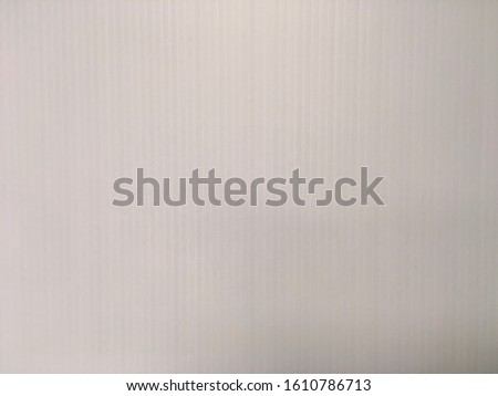 Close up detailed photo of corrugated plastic blank sign board white sheet with vertical flutes background texture photo