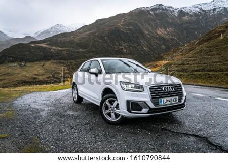 Furka Pass, Switzerland - Dec 19, 2019: Audi Q3 driven on Swiss roads #1610790844