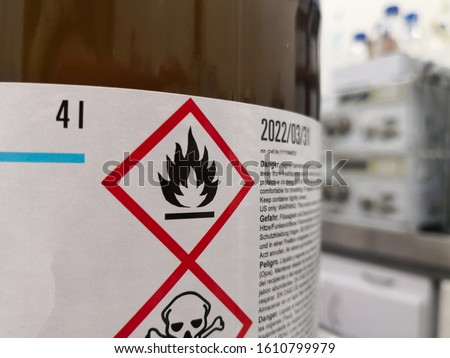 Label of a hazardous chemical in a scientific laboratory. Warning icons on flammability and toxicity. Royalty-Free Stock Photo #1610799979