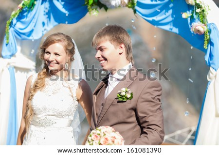 Couple at Outdoor Wedding Ceremony #161081390