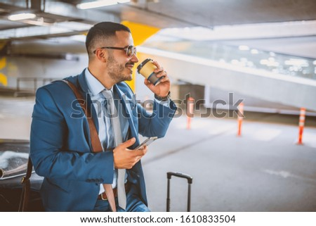 Portrait of a young businessman with a suitcase.Businessman traveling concept. #1610833504
