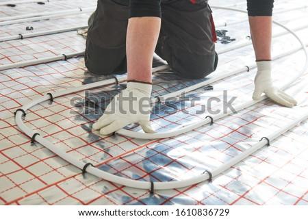 underfloor heating installation. Warm floor heating system Royalty-Free Stock Photo #1610836729