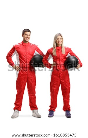 Full length portrait of a team of a male and female car racers holding helmets isolated on white background Royalty-Free Stock Photo #1610853475