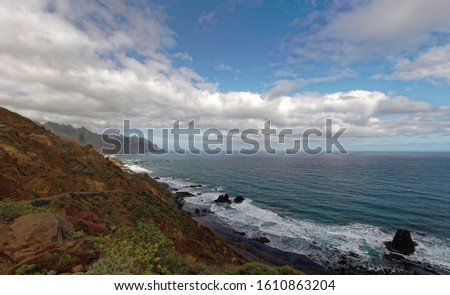 View of the sea waves and fantastic rocky coast. View of calm turquoise sea water and rocks. Drawing of the sea surface and rocky coast. Rocky coast of the Peninsula #1610863204