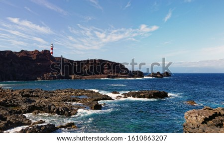 View of the sea waves and fantastic rocky coast. View of calm turquoise sea water and rocks. Drawing of the sea surface and rocky coast. Rocky coast of the Peninsula #1610863207