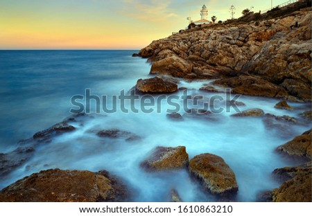 View of the sea waves and fantastic rocky coast. View of calm turquoise sea water and rocks. Drawing of the sea surface and rocky coast. Rocky coast of the Peninsula #1610863210