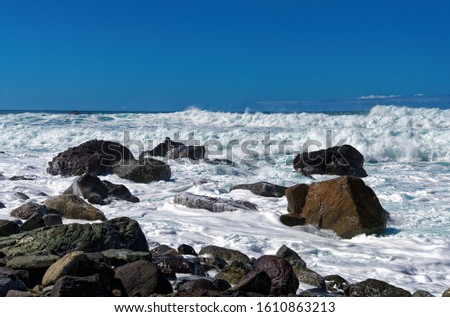 View of the sea waves and fantastic rocky coast. View of calm turquoise sea water and rocks. Drawing of the sea surface and rocky coast. Rocky coast of the Peninsula #1610863213