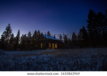 Old shack at night in winter #1610863969