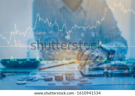 Double exposure of businessman working with candlestick graph chart with indicator and Cryptocurrencies graphs trading including of up and down trend with divergent reverse price pattern. #1610941534