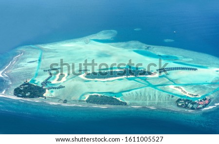 Bird eye view of Maldive Island Colorful sea and luxury Resort in Maldives atolls top view of coconut trees best place to visit in holidays #1611005527