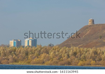 Autumn landscape, dark blue water, last warm days, river, trees, windy weather, yellow-red autumn leaves #1611163945