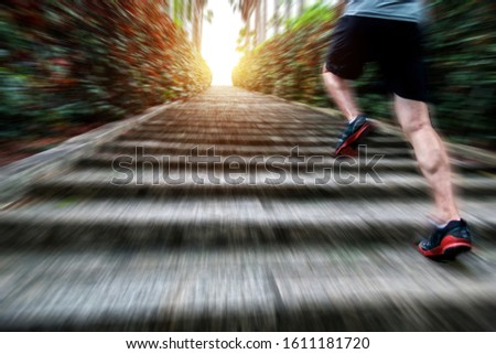 Low section of runner athlete running on staircase. #1611181720