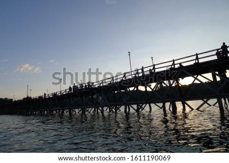 sunset and old bridge. Sangkhla buri Thailand October 27, 2018 #1611190069