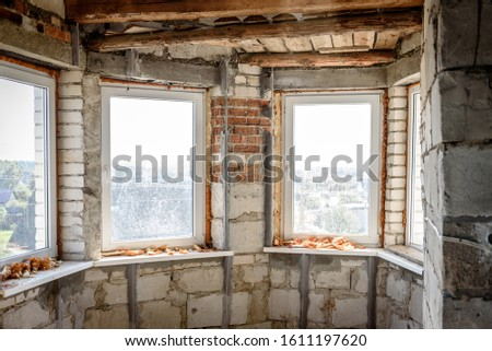 The use of aluminum rails for preparing walls for applying plaster. Installation of guides for plaster. Installation of metal lighthouses on a brick wall. #1611197620