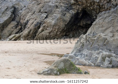 A craggy little cave opening in the cliff face at Three Cliffs Bay, The Gower Peninsula, Wales #1611257242