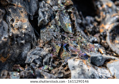 close up of sparkling rainbow of mineral colours found in a volcanic lava flow with outside of picture blurred to give effect to the centre colours, on the Big island of Hawaii