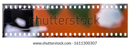 exposed negative film strip template with real light leaks, developed 135 type material (35mm) isolated on white background, blank grained film texture. #1611300307