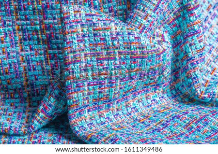 Background texture, pattern. Winter fabric, warm. big braided thread. Blue-red yellow threads. This photo will make your design the best. Wallpapers, pictures, posters. #1611349486
