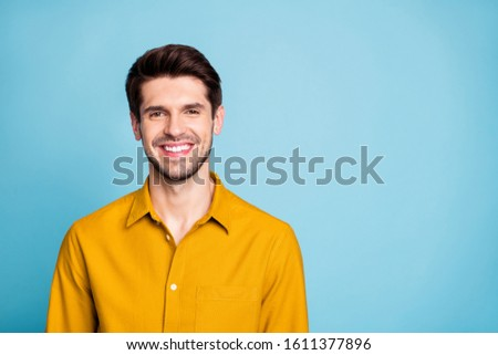 Photo of handsome creative executive director wearing yellow shirt smiling toothily isolated over blue pastel color background #1611377896