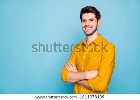 Profile side view portrait of his he nice attractive content cheerful cheery brown-haired guy folded arms isolated over bright vivid shine vibrant blue green turquoise color background Royalty-Free Stock Photo #1611378139
