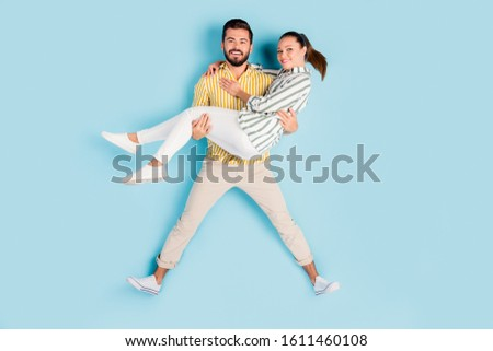 Top view above high angle flat lay flatlay lie concept full length body size view of nice cheery couple guy carrying girl having fun isolated bright vivid shine vibrant blue turquoise color background #1611460108