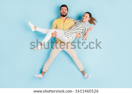 Top view above high angle flat lay flatlay lie concept full length body size view of nice couple guy carrying girl showing v-sign isolated on bright vivid shine vibrant blue turquoise color background #1611460126